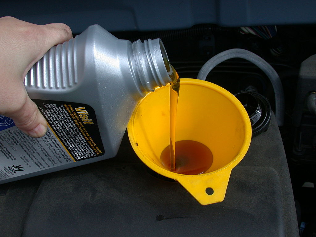 pouring engine oil funnel